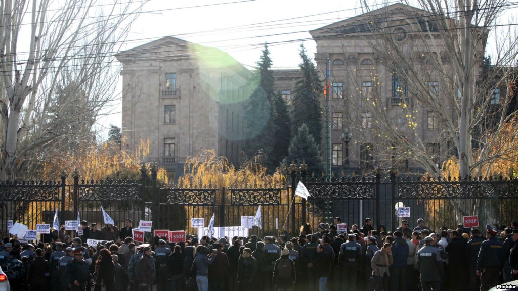 Armenia - Hundreds of people demonstrate against a controversial pension reform outside the parliament building, Yerevan,04 Dec. 2013