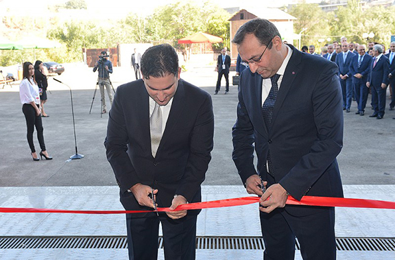 Armenia's Economy Minister Artsvik Minasyan (right) and DFA executive director Karen Mkrtchyan cut the ribbon to the exhibit